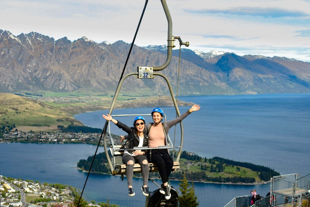 two girls queenstown louge ride cable car smiling